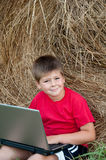 A boy with a laptop Stock Photography