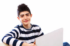 Boy on laptop. Teenage boy on his laptop 24/7 looking happy Royalty Free Stock Photo