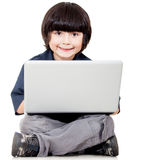 Boy with a laptop Stock Images