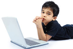 Boy with Laptop. Indian Cute Boy with Laptop Royalty Free Stock Photo