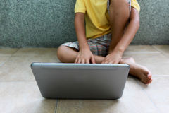 A boy with laptop Royalty Free Stock Photography
