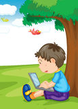 A boy and laptop Royalty Free Stock Image