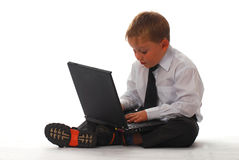 A boy with laptop. Isolated on white Stock Photo