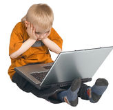 The boy and a laptop Stock Image