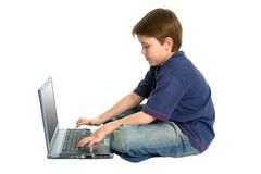 Boy on a laptop Stock Image