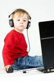 Boy and laptop Stock Images