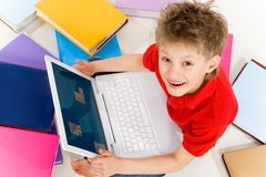 Boy with laptop Stock Photography