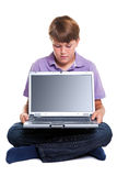 Boy with laptop blank screen Royalty Free Stock Image