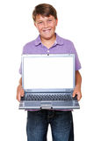 Boy with laptop blank screen. An 11 year old boy holding a laptop computer, isolated on white with clipping path for the blank screen Stock Photos