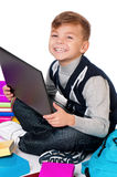 Boy with laptop and books Stock Images