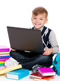 Boy with laptop and books Royalty Free Stock Image