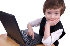 Boy on a laptop computer Stock Images