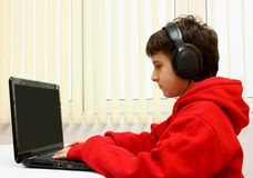 Boy with laptop - computer Royalty Free Stock Photos