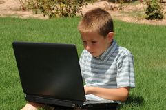 Boy with Laptop Computer Royalty Free Stock Photo
