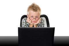 Boy with the laptop Stock Photos