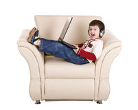 Boy with laptop and headphone. Royalty Free Stock Photography
