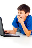 Boy with laptop isolated Stock Images