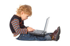 Boy with laptop at profile Stock Images