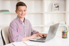 Boy with laptop Royalty Free Stock Images