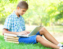 Boy with laptop Royalty Free Stock Photos