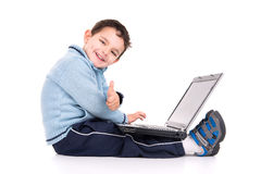 Boy and laptop Royalty Free Stock Photography