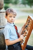 Boy with large abacus royalty free stock images