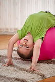 Boy with large ball Stock Images