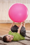 Boy with large ball Royalty Free Stock Photos