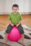 Boy with large ball Royalty Free Stock Photo