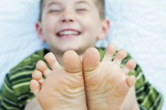 Boy laughing barefoot toes Royalty Free Stock Photos