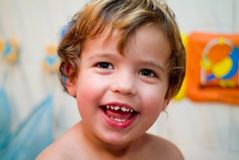 Boy laughing in bathroom Royalty Free Stock Photo