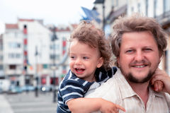 Boy laughing with daddy Stock Photos