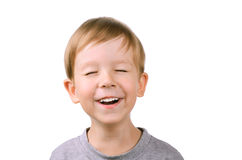 Boy laughing with eyes closed. Boy 5 years laughing with eyes closed. isolated on white background royalty free stock photography