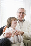 Boy laughing with grandfather Royalty Free Stock Photography