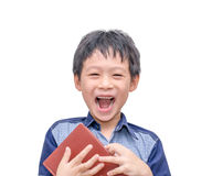 Boy laughing between reading a book Royalty Free Stock Image