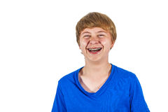 Boy laughs explosively Royalty Free Stock Image