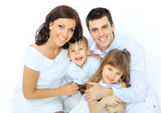 Boy laughs with family Stock Photo