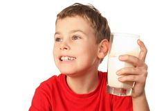 Boy laughs and holds container of milk Stock Photos