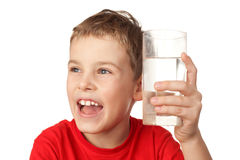 Boy laughs and holds in hand glass with water Royalty Free Stock Images