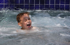Boy laughs in spa or jacuzzi Stock Images
