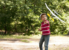Boy launching toy airplane Stock Photography