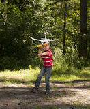 Boy launching toy airplane Royalty Free Stock Photo