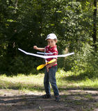 Boy launching toy airplane Royalty Free Stock Images