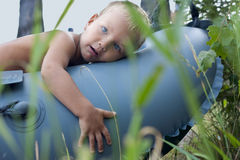 The boy lay on the boat. Stock Images