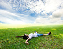 Boy lay on the grass feel relax Royalty Free Stock Image