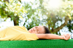 Boy lay on the green lawn Royalty Free Stock Images