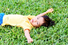 Boy lay on the green lawn Royalty Free Stock Photos