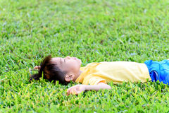 Boy lay on the green lawn Stock Photography