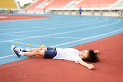 Boy lay on the running track Stock Photography