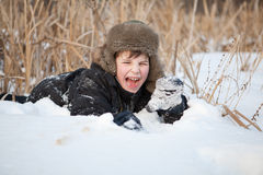 Boy lay on snow and cries, winter Stock Photography